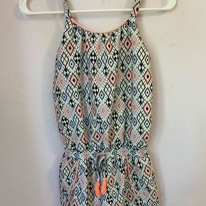 White and pink patterned romper.